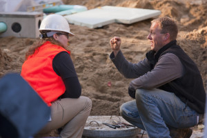 Female engineer discussing with a man at a construction site